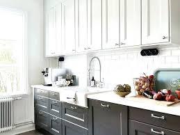 white kitchen white appliances black and white countertops black and white kitchen cabinets