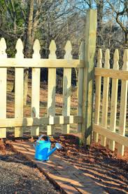 building a vegetable garden fence video and photos