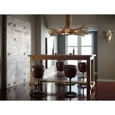 unusual chandelier over narrow rectangular wood pub table and