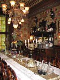 victorian style dining room with wallpaper and chandelier and