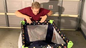 porta cot how to fold it down or putting it up easy youtube