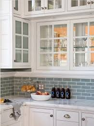 white cabinets with frosted glass blue subway tile backsplash