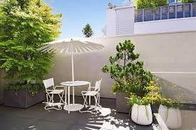 Garden Containers Large - large round modern terrace garden containers planted with citrus