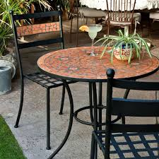 3 piece black metal patio bistro set with terra cotta tiles