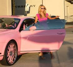 pink bentley paris hilton matches her pink dress to her pink bentley while