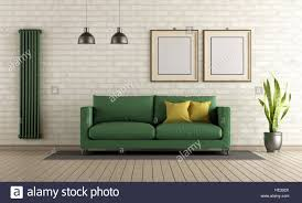 Modern Brick Wall by Modern Living Room With Green Sofa And Vertical Heater On Brick