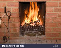 open fire burning in a brick fireplace stock photo royalty free