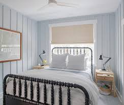 blue walls with black jenny lind bed cottage bedroom