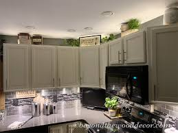 how to decorate above kitchen cabinets 2020 decorating above kitchen cabinets beyond the wood diy