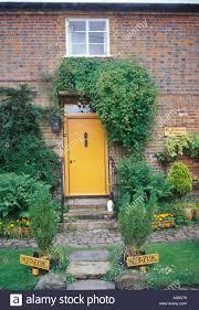 avebury wiltshire england detail brick cottage front door painted