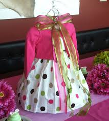 use a baby dress as the centerpiece for a baby shower baba