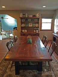 this reclaimed barn wood sawbuck trestle table is a focal point in