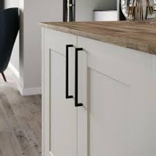 thin black kitchen cabinet handles add a sophisticated and modern finishing touch to your