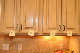 How To Restain Kitchen Cabinets by Cabinet Spraying Kitchen Cabinet Doors Spray Painted Oak Cabinet