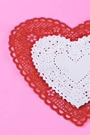 heart shaped doilies heart shaped doilies on pink paper background stock