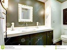 dark bathroom vanity cabinet with white top stock photo image