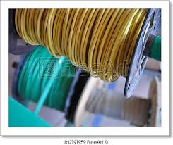 free art print of rolls of electrical wire green and yellow rolls