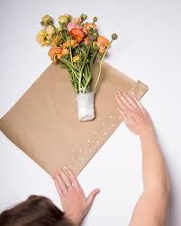 flower wrapping paper how to wrap bouquets of fresh flowers a genius freshness trick