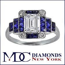 engagement ring emerald cut diamond art deco step up engagement