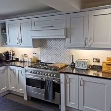 is it better to paint or spray kitchen cabinets grey spray painted kitchen cabinets totally transform this