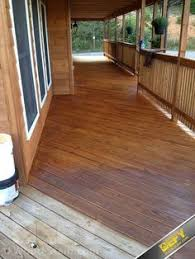 bright sunshine on deck with clove brown color deck stain clove