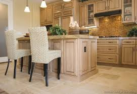 White Wash Kitchen Cabinets A Traditional Kitchen Featuring Whitewashed Maple Wood Cabinets