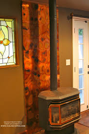 flamed copper wall panel behind this fireplace copper