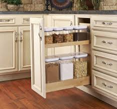 double brown wooden pull out shelves for spices storage placed on