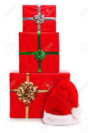 santa claus hat and three gift wrapped presents