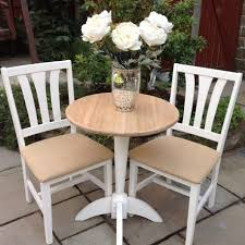shabby chic round oak dining table u0026 2 white hessian covered