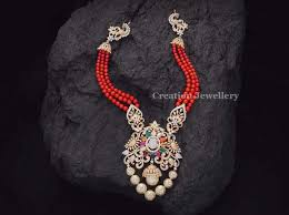 coral set by creations jewellery indian jewelry and