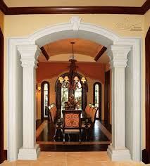 the dining room entrance is encased in gorgeous marble columns