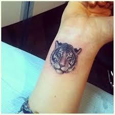 small tiger on wrist tattoos tiger