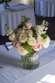 wedding table arrangement made of gypsophila pink roses cream