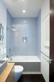 small bathroom remodel ideas with square bathtub under lighting on