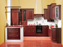brown kitchen paint colors with wood cabinets on the red floor can