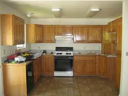 white granite countertop brown wood paint cabinets design gray
