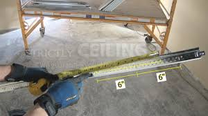 Drop Ceiling Grid by Install Grid And Track System In Basement Drop Ceilings