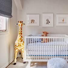 forest animal wall with giraffe stuffed animal nursery
