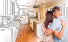 young military couple looking inside custom kitchen and design