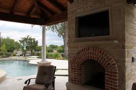 outdoor tv mount with brown wooden frame on brick stone fireplace mantel jpg