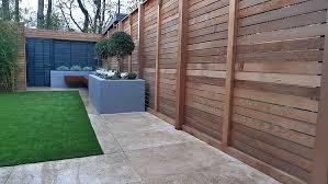 artificial grass tile grey colour scheme walls fence planting