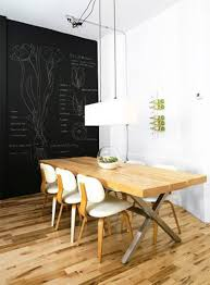dining room with white wall and hanging wine rack and chalkboard