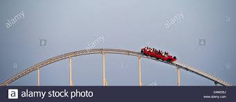 roller coaster abu dhabi speed visitors of the theme park sit in a rollercoaster in