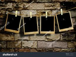 old picture frame hanging on clothesline stock photo 111743627