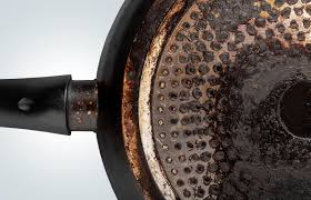 how to remove grease from the top of kitchen cabinets 7 tricks to clean burnt grease a frying pan bottom