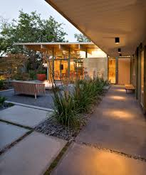 skillion roof patio midcentury with floor to ceiling windows