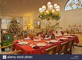 dining room table set for christmas dinner in living room of