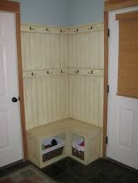 corner fix for a small mudroom built in bench with basket storage