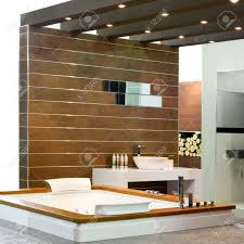 Contemporary Bathroom Contemporary Bathroom With Wooden Walls And Spa Bathtub Stock